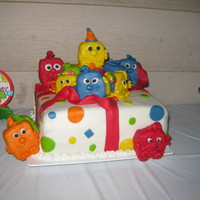 Opened Gift I want the cake to look like a present with the mini monster coming out. cake covered in mmf. Monsters are made out of rkt. covered in mmf...