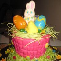 Easter Bunny chocolate cake with basket made out of rkt. handle broke hand to put a wire to hold it together.