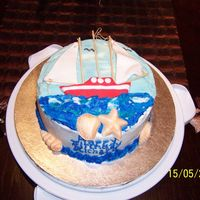 Sailing marble cake with chocolate hazlenut filling and buttercream dream frosting. Fondant boat, rafia rope and wooden skewers for masts. Moulded...