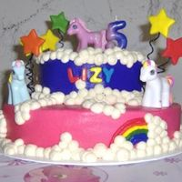 "Little Pony Birthday Cake This cake was done for my daughter's 5th year birthday. She wanted no filling so the cakes are appx 2 1/2 "" tall. Yellow cake and..."