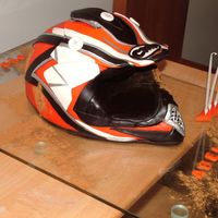 Dirty Bike Helmet This cake was a real challenge for the boys mum deseperatly wanted a 3D dirty bike helmet just like her year old son used in competition. I...