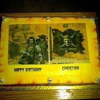 Pirates Of The Carribean  Made for a friends grandsons Bday, a big fan of Pirates! Two 1/4 sheets, white and chocolate, BC icing, airbrushed color and edible image...