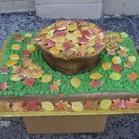Basket Of Leaves Half and Half chocolate and white, with all BC icing. Basket is both swirled together. Leaves are made from MMF. Airbrushed base and basket...