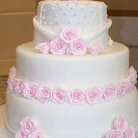 Pink Roses Wedding Cake this was a white wedding cake with white chocolate raspberry buttercream filling. i was extremely sick when i did this and i rushed a lttle...