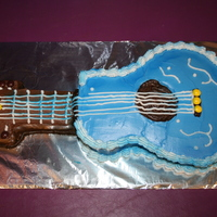 Guitar Cake I carved this cake from a 9x13 cake for my daughter's 8th birthday. I had seen the idea in Family Fun. I used Skittles since my...