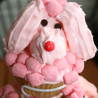 Pink Poodle Cupcakes I saw these pink poodle cupcakes online somewhere, but couldn't find pink Circus peanuts for the ears so I covered the orange Circus...