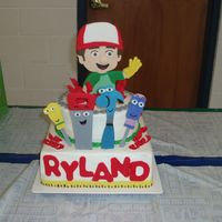 Handy Manny This is a Handy Manny cake I did for my nephew. The cake white and chocolate with BC icing and fondant accents. Handy Manny and all the...
