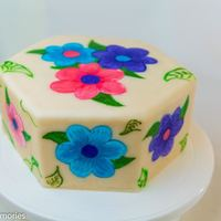 Birthdays Hand painted fondant covered hexagon cake. Vanilla pound cake with Swiss buttercream.
