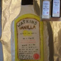 Watkins Vanilla For a Watkins party. Vanilla cake, Oreo filling, whipped topping. Hand painted fondant label. Inset are actual Watkins Vanilla bottles.
