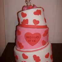 Valentines Topsy Turvy This is a cake that me and my business partner made for a friends coffee shop window. It is our first attempt at a tiered cake and our...