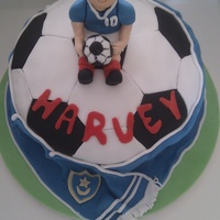 "Happy 10Th Harvey football cake 8 "" butter and strawberry cake. decorated and accents in fondant"