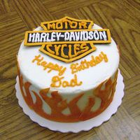 "Harley Birthday 6"" carrot cake with buttercream icing. Logo is fondant with buttercream letters. Flames are orange fondant brushed with red and yellow..."