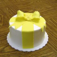 "Big Yellow Bow 6"" lemon cake with buttercream. Fondant ribbon and gumpaste bow."