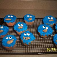 Cookie Monster Cupcakes I had left over blue icing and a bunch of three year olds coming over fora cookout. We also went to see Sesame Street Live the next day....
