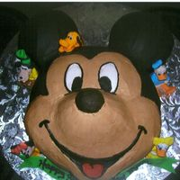 Mickey Mouse   Mickey is all butter cream and the small characters are hand molded from fondant.