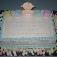 "Baby Shower Baby shower cake. 2 layer 9x13 inch cakes with BC icing. I used the Wilton baby and blocks for toppers. It says, ""Someone special,..."