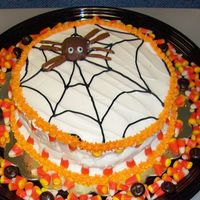 Spider Web I made this kinda last minute for work...store bought icing, orange buttercream icing borders, candy corn and junior mints on cake platter...