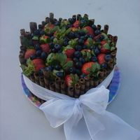 Dsc05005.jpg chocolate devils food cake with white BC topped with strawberrys and blueberries. thanks for looking