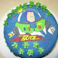 Buzz Lightyear After I had completed Wilton Course 1. I did the name in color flow that I did on my own. :o) Transferred this one with Piping gel --- what...