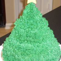 "Christmas Tree Cake here's my attempt at a christmas tree cake!it's a 4 tier cake -- 8"", 6"", 4"", and cupcake (top tier). chocolate..."