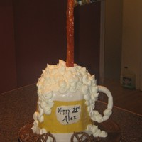 "Beer Mug beer mug chocolate cake with vanilla bc filling and icing covered in fondant. fondant accents. hard candy ""flow"" of beer. Thanks..."