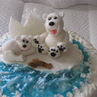 Polar Bears  Fondant gum paste polar bears, fish, and other decorations. First time doing bears, one looks more like a dog, Vanilla cake, butter cream...