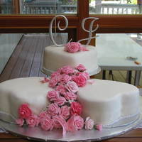 Christine's Wedding Cakes  Heart shaped cakes, pink roses and butterfles. Chocolate, White and butter pecan cakes, butter cream, fondant covered, hand made fondant/...
