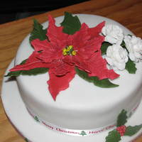 Poinsetta & Roses   Fondant/gum paste flowers, lemon cake, fondant covered, thanks to all the beautiful poinsetta cakes for the idea.