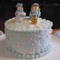 Singing Praises   Fondant and gum paste figures, snow flakes, silver dragees, butter cream icing.