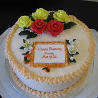 Birthday Cake  Birthday cake for a friend. His wife likes yellow and red roses, and wanted an orange cake. Orange flavored cake and butter cream icing....
