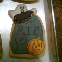 Rip Halloween Cookies Sugar cookies covered in amazing glaze. Each cookie was made seperate and then placed on or behind the tumbstone cookie. I did make an even...