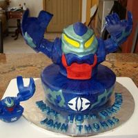 Bakugan Cake Body is RKT covered in fondant and then painted with watered down paste icing color royal blue. The green is petal dust & white pearl...