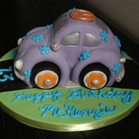 "Mckenzie's Vw Bug Cake carved from 2 8"" round strawberry cakes. Ended up being about 8 long by 4 1/2 wide by 6 1/2 tall. Covered with homemade vanilla..."