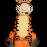 Tigger Stacked and carved vanilla buttercake, covered in chocolate ganache and fondant, he's not perfect, but I'm really pleased with...