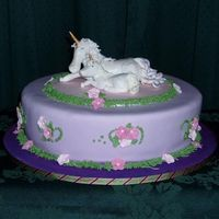 Unicorns  Inspired by JaneK's unicorn and fairy cake. Hand modelled unicorns from gumpaste, gumpaste flowers. Cake is chocolate cake covered in...