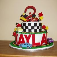 "Kaylan's ""cars"" Cake Kaylan is crazy about disney cars. I used toy cars to embelish the sugarpaste and gumpaste decorations. I would have loved to have had a..."