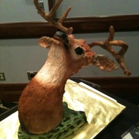 Grooms Cake This is a groom's cake. The plaque is chocolate cake with fondant, the deer head is chocolate cake with ganache and cereal treat...