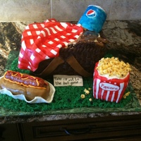 Take Me Out To The Ballgame.... 100% edible. The basket was cake, peanuts were gumpaste, blanket was fondant, hot dog was cereal treat as was the popcorn bucket and the...