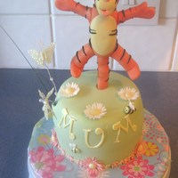 Tigger Cake small victoria sponge cake with BC filing, decorated with fondant figures and flowers