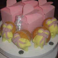 Baby Shower Tummy Cupcakes basic sponge cupcake, decorated with fondant pregnant tummy toppers.