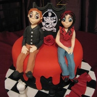 My Daughters Twilight Cake red chocolate sponge, covered with fondant decorations.cushioned effect on the outside with dripping blood on the top and sides. Two...