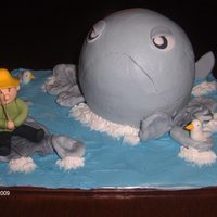 Whale Of A Tail This cake was for a gentlemen who was retiring. He loved to fish. All of the details were made of fondant.