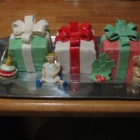 Christmas Cake A co-worker asked me to make a Christmas Cake to impress her mother-in-law! It was fun, I love making bows!