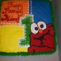 Elmo Patchwork   Cake was decorated according to the pattern on the plates and napkins. all butter cream
