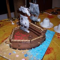 Pirate Ship I made this cake for a pirates of the caribbean party. The sails are not edible.