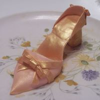 My First Shoe Made from gum paste. Brushed in amber luster dust.