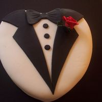 Tuxedo Groom's Cake Fondant jacket, lapel, bow tie, and buttons. Sugar paste rose and leaf.