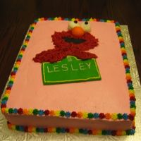 Elmo Cake I am the first to acknowledge that pink and Elmo don't work well together.....not my choice! My three year old went around telling...