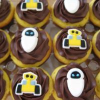 Wall*e And Eve Yellow cupcakes with Martha Stewart's ultimate chocolate frosting with Wall*E and Eve decorative sugars. I also made chocolate...
