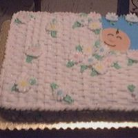 "Picture_37~0.jpg This is an 11X15"" yellow cake with Buttercream frosting. Basketweave on top with fondant babyhead. Daisies are made with royal icing..."